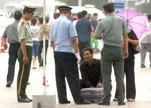 Police check bags at security checkpoint in Beijing