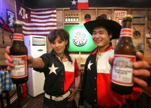 Chinese staff celebrate the Fourth of July at their restaurant in  Beijing