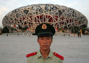 Soldier stands guard in front of National Stadium in Beijing