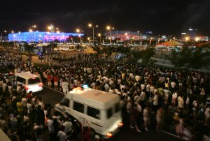Thousands of spectators converge on the Olympic Green to watch fireworks in Beijing